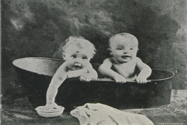 black and white vintage image of twins in a bathtub