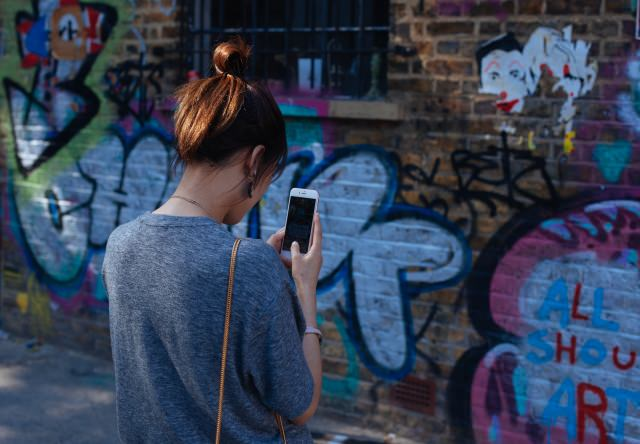 image of a girl in front of graffiti