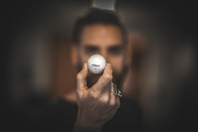 image of a man Holding a golf ball